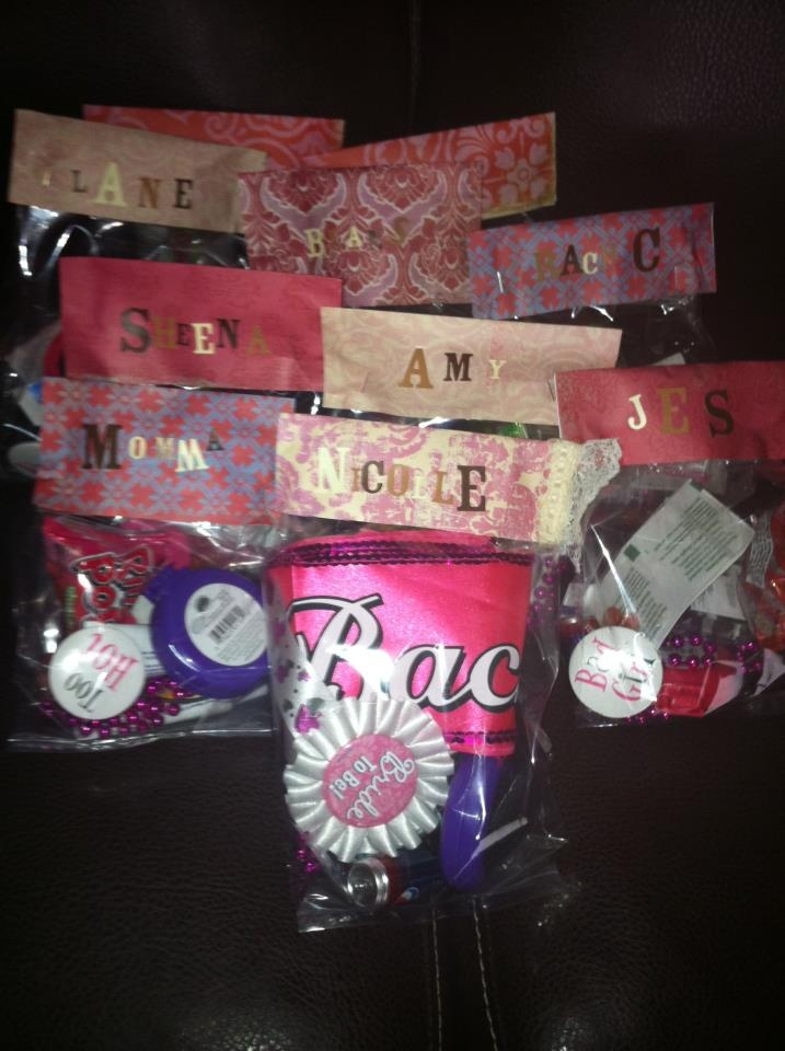 Bachlorette Party Survival Kit--chapstick, antibacterial gel, hairtie, brush/mirror, ring pop, advil, bandaid, pins, necklaces whatever else you want!...Just bought bags in the pastry section on the hobby store and used scrapbook paper and staples for the closure!