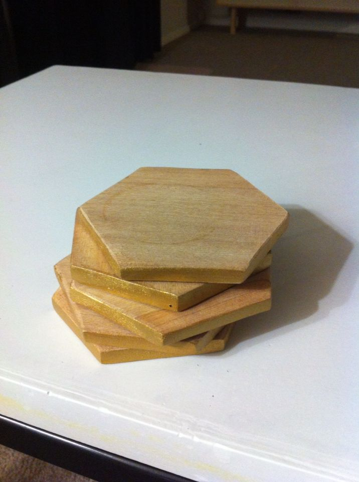 Gold tip coasters made from recycled Rimu