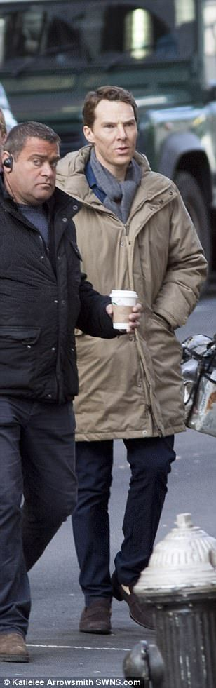 Cosy: The superstar was spotted prepping for another scene on the set, which saw a large part of Glasgow City Centre closed until November 3