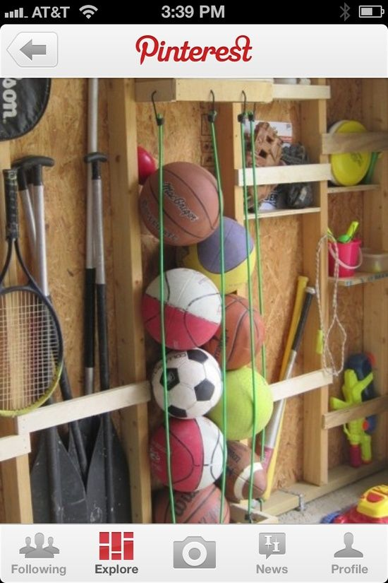 Garage ideas - organize balls for various sports. Love the bungee ball holder!!