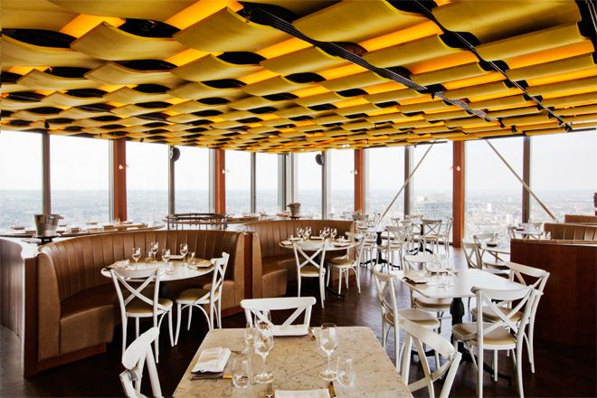 Duck & Waffle - 40th floor of the Heron Tower right by Liverpool Street Station. Amazing views of the city, very reasonable price for breakfast (around £25 for a full English) and open 24 hours a day - ££/££££