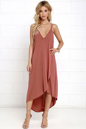 Your mood will instantly be lifted once the Mood and Melody Washed Red High-Low Dress starts singing its song! Slinky stretch knit falls from twin spaghetti straps into a triangle bodice and cascading tulip skirt ending in a high-low hem. Crisscrossing straps at back.