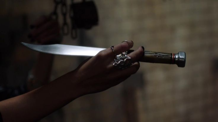 Kael giving Thalia a dagger and telling her that she would be safer if she has this around when he is training the Denai