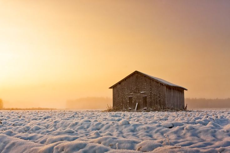 Old Barn House In The Winter Sunrise