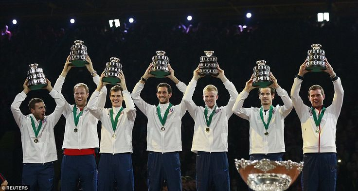 The winning British team hold up their trophies. They are from left, - Daniel Evans, Dominic Inglot, Jamie Murray, James Ward, Kyle Edmund, Andy Murray and captain Leon Smith