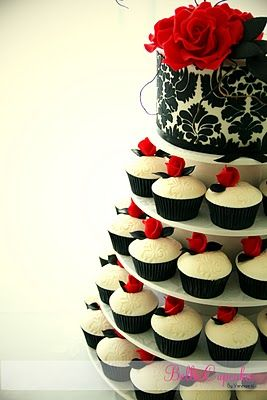 I love cupcake wedding cakes. Maybe not this color for me but something along these lines
