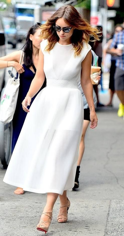 Tea length white dress and neutral strapped heels