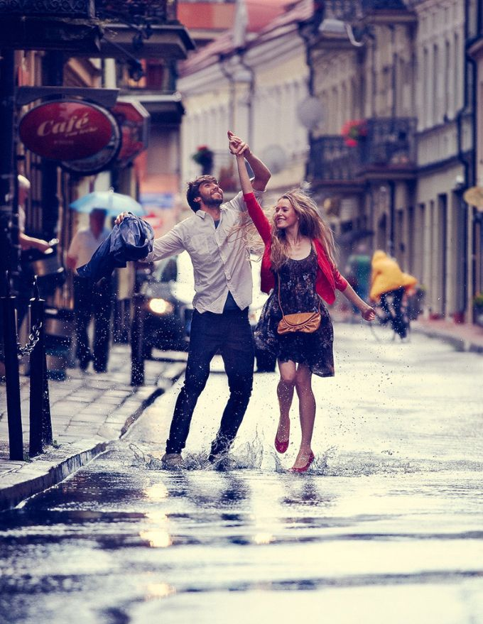 In the rain. Omg,they look so happy:) some man please just grab me and dance in the rain!!