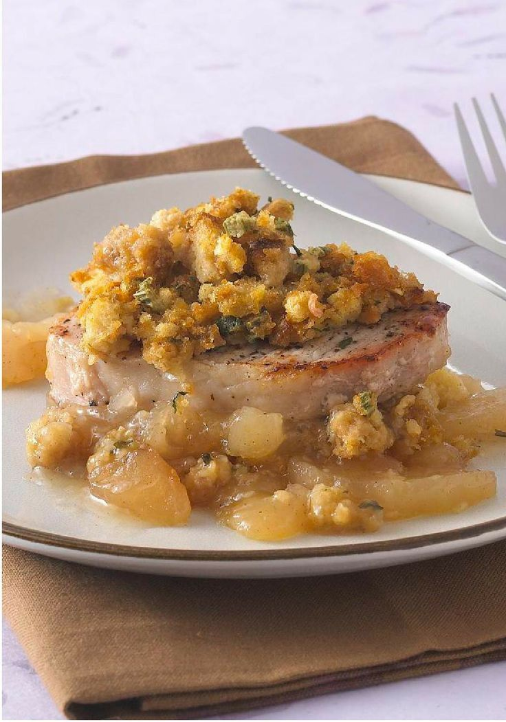 Pork Chops with Apples and Stuffing -- You won't believe how fast and easy it is to create this pork chop recipe any night of the week--complete with savory stuffing and baked apples.