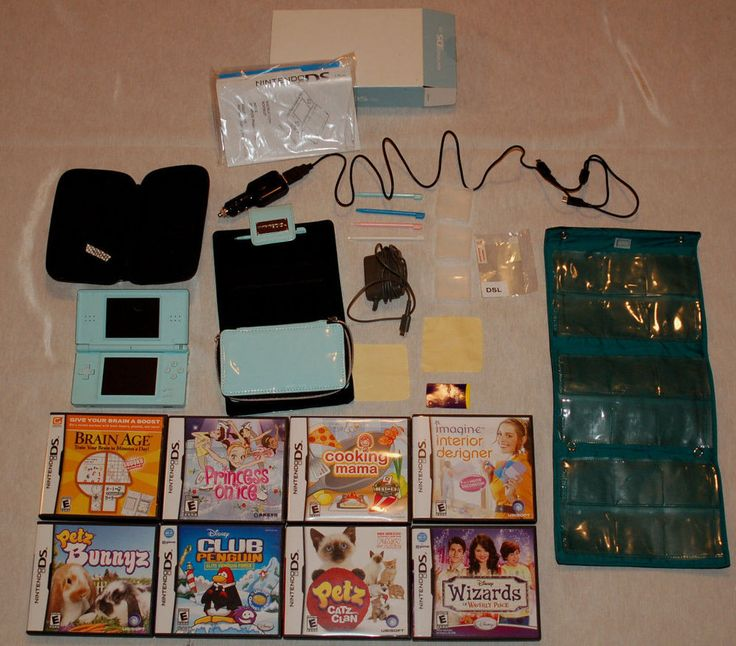 Nintendo DS Lite Ice Blue Handheld Console 8 Games Charger And Accessory Bundle