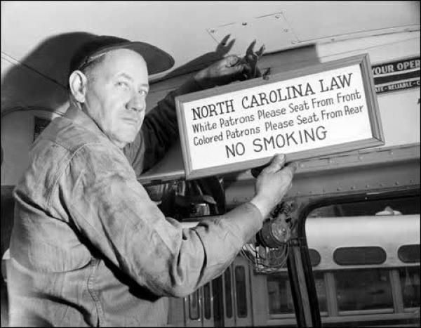Sign For Segregated Seating Being Placed On A Bus In North