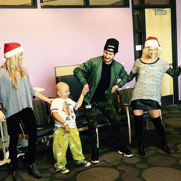Star Tracks: Thursday, December 24, 2015 | DANCE PARTY | Just in time for Christmas, Dancing with the Stars pros Lindsay Arnold, Val Chmerkovskiy and Peta Murgatroyd spread holiday cheer at Children's Hospital Los Angeles on Wednesday, dancing with patients and handing out holiday gifts.