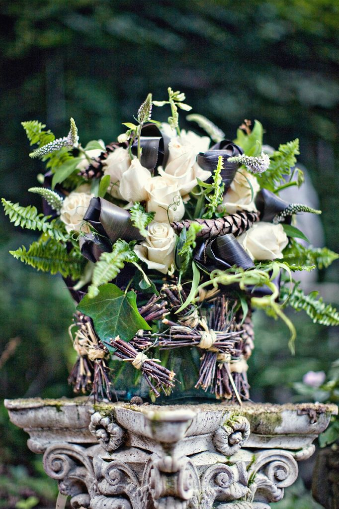 A sense of drama in this rustic floral arrangement