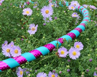 How Heavy Should Your Hoop Be To Lose Weight Hula Hooping? - Ruby Hooping