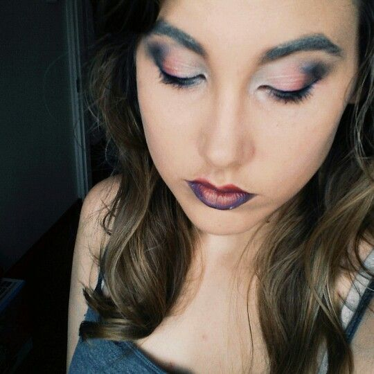 Sombre lips and colourful eyes
