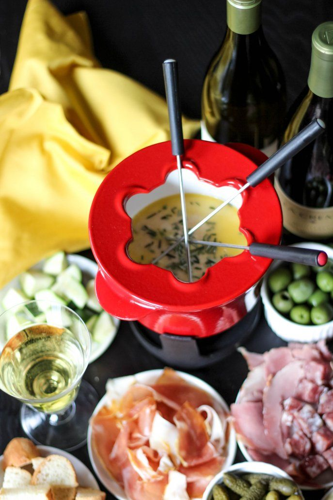 Havarti Cheese Fondue with charcuterie, veggies and olives.