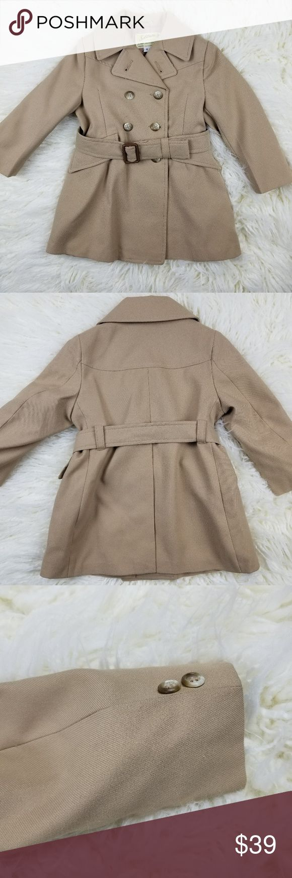 "VINTAGE Girls Trench Coat Solitaire Brand, Size 4 VINTAGE Girls Trench Coat Solitaire Brand, Size 4.  Stunning trench for your mini-me with all of the bells and whistles of the big coats.  Belted, pockets and lined.    Excellent, near mint condition.  No flaws noted.  This is a vintage size 4 so please double-check measurements for fit.    Measurements are approximate and taken with the garment lying flat & unstretched:  Shoulder seam to shoulder seam:  10.5""  Armpit to armpit:  13.5""…"