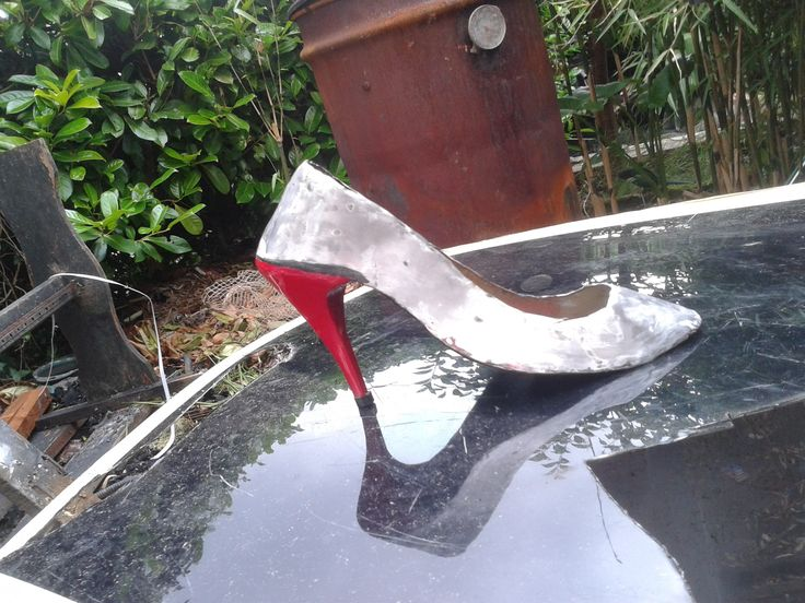 metal sculpture woman's shoe made from a car bonnet the first thing I made with my welder