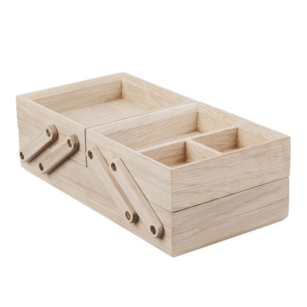 wooden desk organizer--Actually, what I have is a sewing box just like this, except there are no inner partitions, and it has two lids with wooden knobs, and a carrying handle in the middle. I found it in the rain, put out for trash day! Someone had made it by hand! I love it.