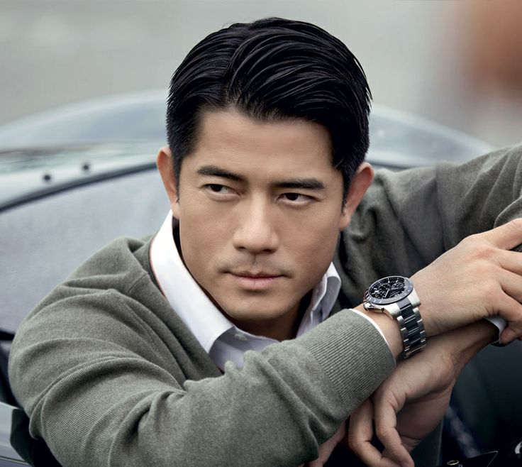 Asian style. Great hair, expensive watch, and a fitted pull over sweater with a pressed collard shirt. Confidence and success mixing at their best!