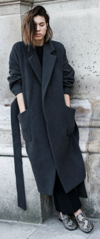 Kaitlyn Ham styles her maxi coat with a pair of faux snakeskin loafers and black flares.   Outfit: Raey at Matchesfashion.com.