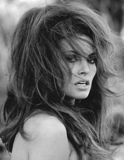 This iconic bombshell (Raquel Welch nee Tejada) rocked sexy bedroom hair. Hell, she still rocks at age 75. A timeless exotic beauty.