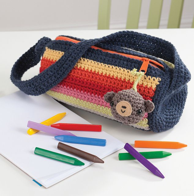 little crochet duffel from forthcoming book, Amigurumi on the Go by Ana Paula Rimoli, could use for crochet hooks