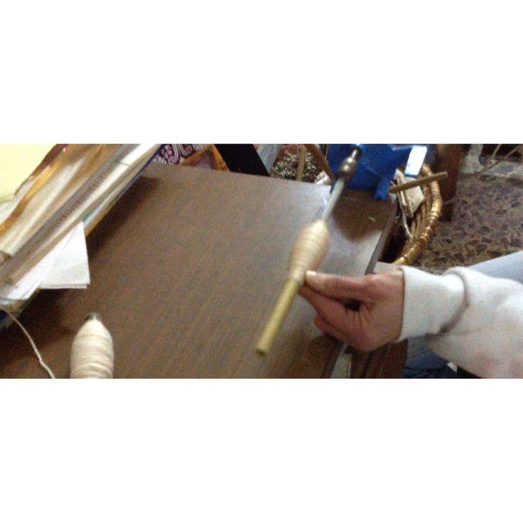 Isa prepping a bobbin.