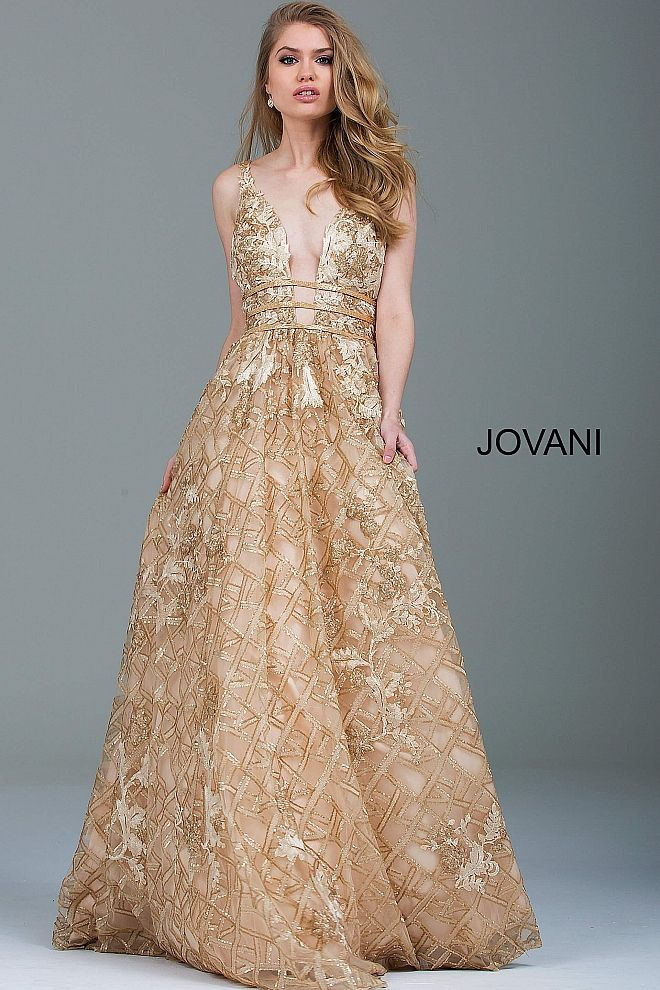 Floor length gold embellished and embroidered A-line evening gown with beaded waist features sleeveless bodice with plunging neckline and open back.