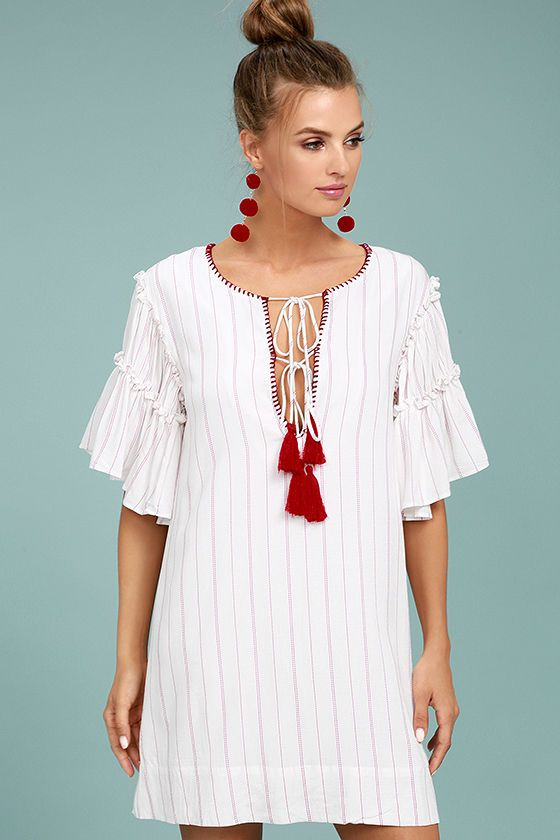 The Moon River Johnny Red and White Striped Shift Dress is the recipe for a good time! Red and white striped, gauzy woven rayon shapes a notched neckline accented with embroidery and tasseled ties. Wide-cut, ruffled short sleeves and shift silhouette.