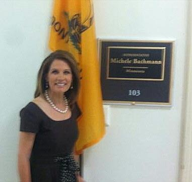 Minnesota Rep. Michele Bachmann, posed outside her House office with the Tea Party flag. The flag stands in the spot traditionally reserved for state and U.S. flags. EVERY member of Congress, except Bachmann, flies either their States' flag or the U.S. flag, or both.   MICHELLE BACHMANN - WHO DO YOU SERVE!?: Political Truths, Heart Liberal, Opening Truths, Republican Clown, Sue, American Revolutionary War, Liberal Politics