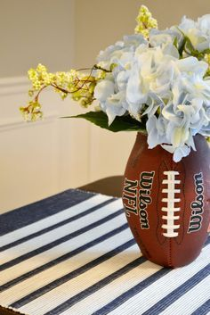 Love this cute and EASY DIY Football vase! Cute centerpiece for the superbowl!