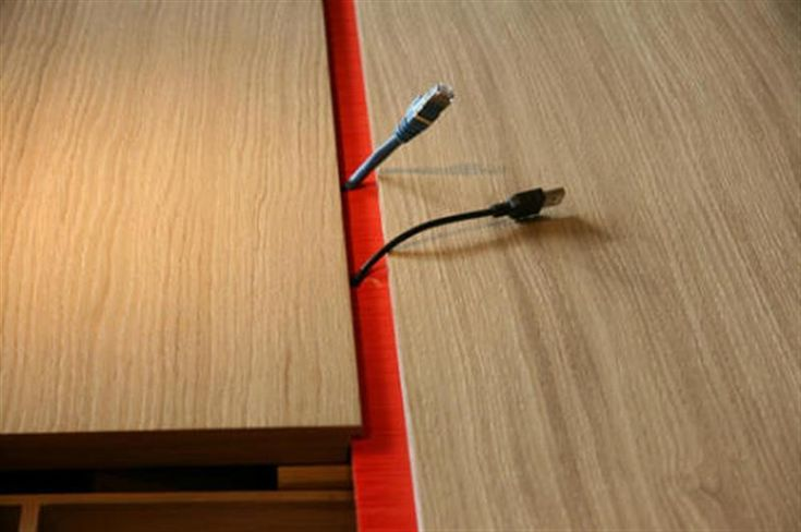 Laptop desk cable management storage system