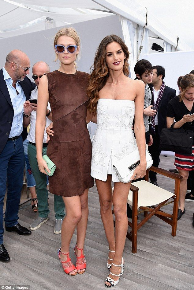 Amazing: Toni caught up with fellow model Izabel Goulart who wore a cute white embellished...