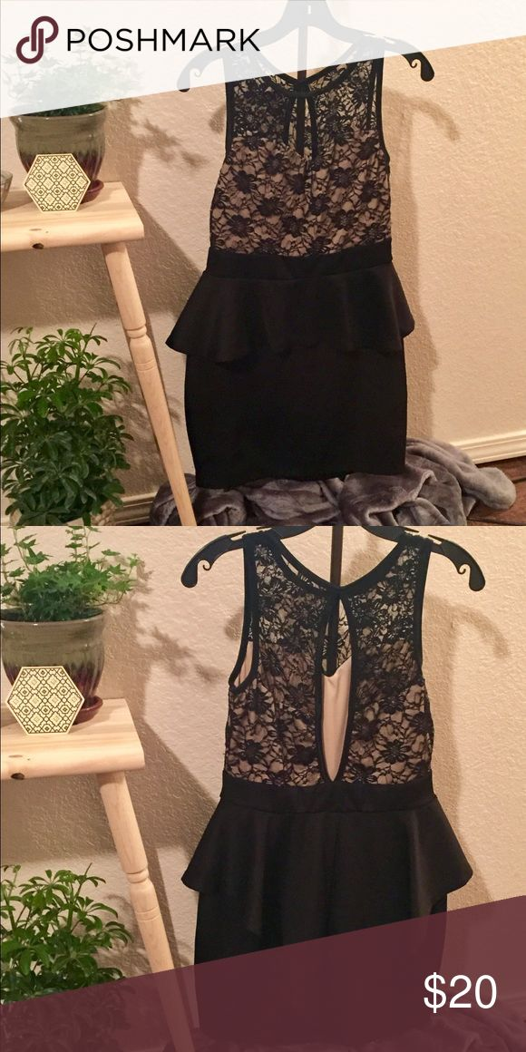 ✨🖤🥂Very sexy little black peplum dress ✨🖤🥂 Worn once for my birthday and then dry cleaned. Mini length dress with black lace too and nude bodice, peplum waistline short in front and long in back, keyhole back. It is stretchy so would fit medium to large Dresses