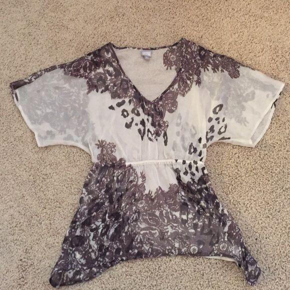 Converse sheer shirt! Super cute, waist hugging flowy shirt that can be worn with so many outfits! Mix of lace, cheetah and floral patterns make this shirt complete! Converse Tops Blouses