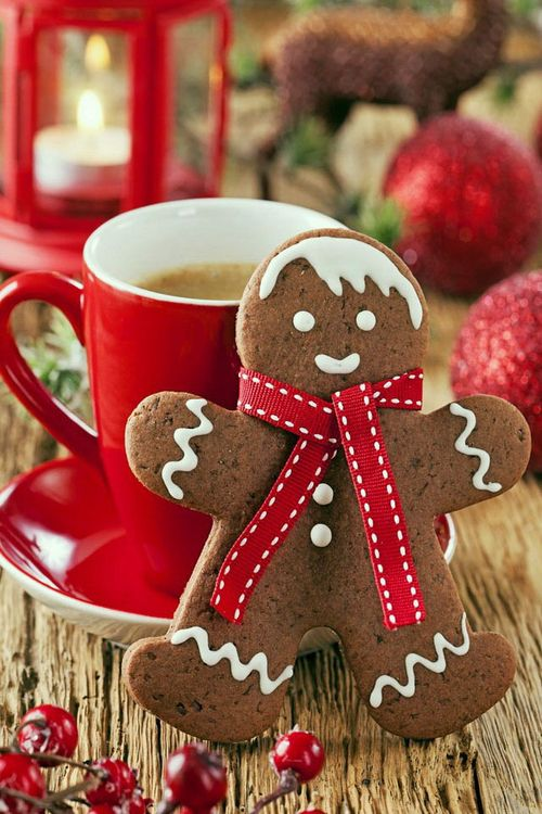 Christmas spirit gingerbread man cookie with cup of coffee