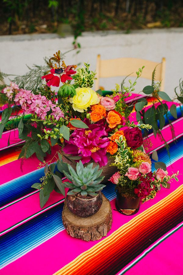colorful centerpieces - photo by Amber Vickery http://ruffledblog.com/mid-century-mexican-wedding-at-the-belmont-dallas