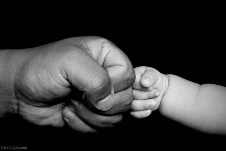 Father and son fist love family cute baby dad father's day