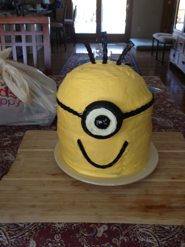Minion Cake for our Cub Scout Cake Derby  The entire cake had to be edible.  The eye is a chocolate cover donut with white and black icing.  Black twizzlers were used for everything else.  Instead of dowels to support the cake I used pretzel stick.