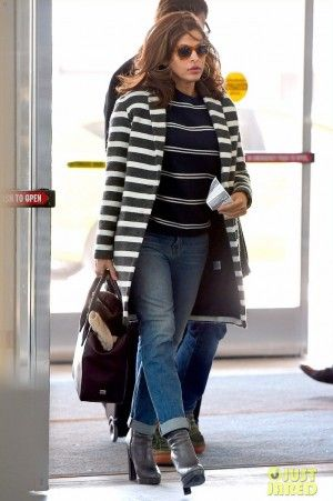 Eva Mendes wearing Louis Vuitton Monogram Canvas Pegase 70 Luggage, Mother the Brother Jeans in Even Hippies Get the Blues and Maje Goelette Striped Wool Coat