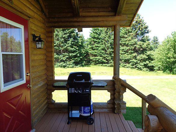 Single cottage porch with bbq, Cabot Trail www.cajuncedarlogcottages.com