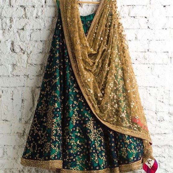 Bottle green lehenga with gold blouse and beige net dupatta o purchase mail us…