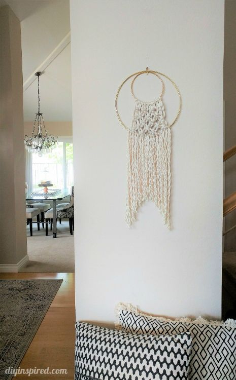We can't help but feel inspired by the macramé trend and we love this diy tutorial from @diyinspired . Learn how to make this simple wall hanging idea using yarn, hoops and scissors.