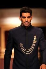 I love the chain- you can use it to match what meghas wearing- match her jewelry! celebrity men indian wear - Google Search