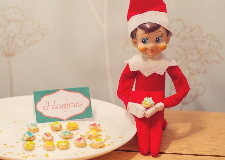 Yummy elf doughnuts (okay, cheerios with icing and sprinkles on)