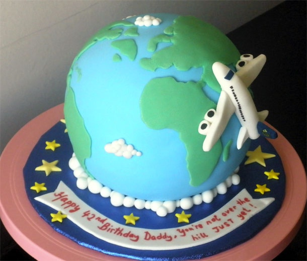 Globe Cake. Maybe add spray paint to the blue and green.