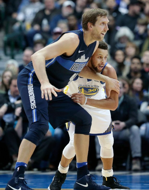 Dallas Mavericks forward Dirk Nowitzki (41) and Golden State Warriors guard Stephen Curry (30) vie for position on the play during the first half of an NBA basketball game in Dallas, Wednesday, Jan. 3, 2018. (AP Photo/LM Otero)