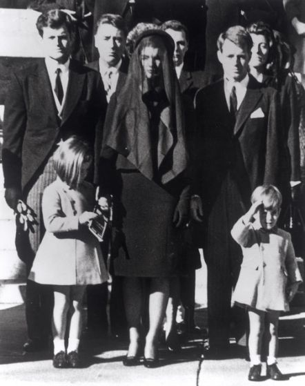 At JFK's funeral. JFK jr is saluting his father's flag draped casket after the funeral. Jackie reminded him that his father had taught him to salute the flag when it passed. November 25, 1963