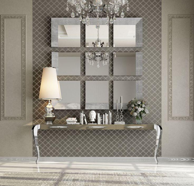 Espectacular consola para recibidor, con patas en acero cromado y espejo en piezas con marcos en laminado en pan de plata #deco #recibidores #hall
